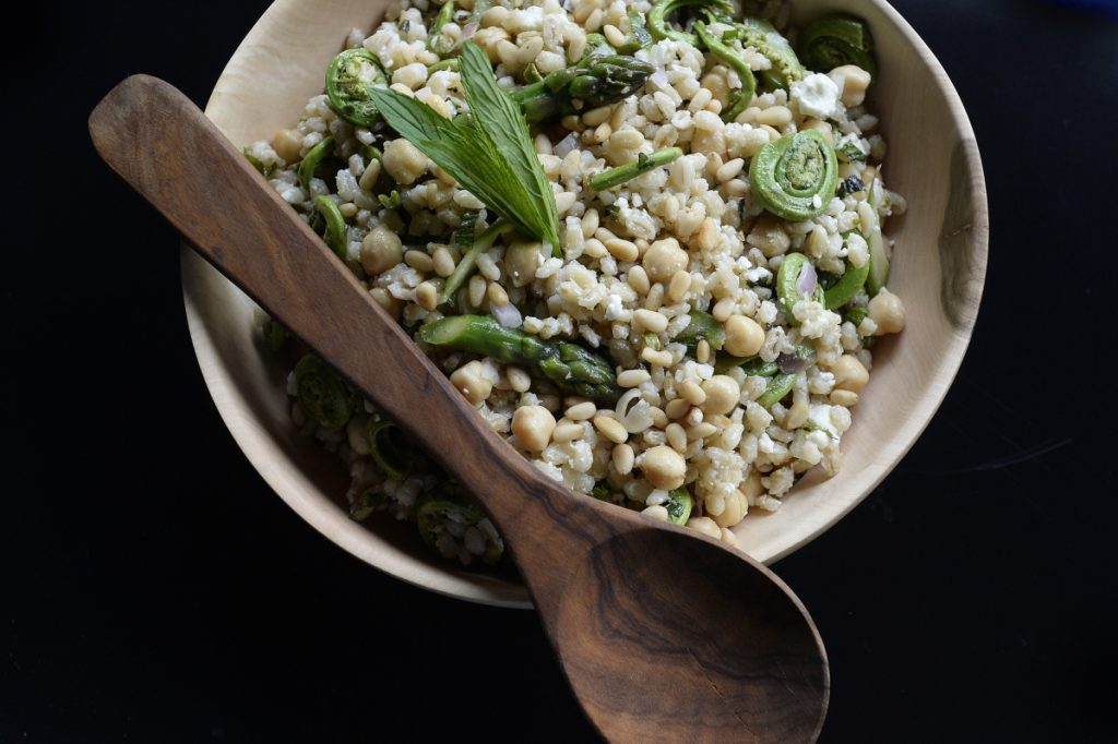 It's probably too late in the season to find fiddleheads for this Barley-Fiddlehead-Asparagus salad, but you can look in your fridge or garden and substitute whatever vegetable or herbs are near at hand.