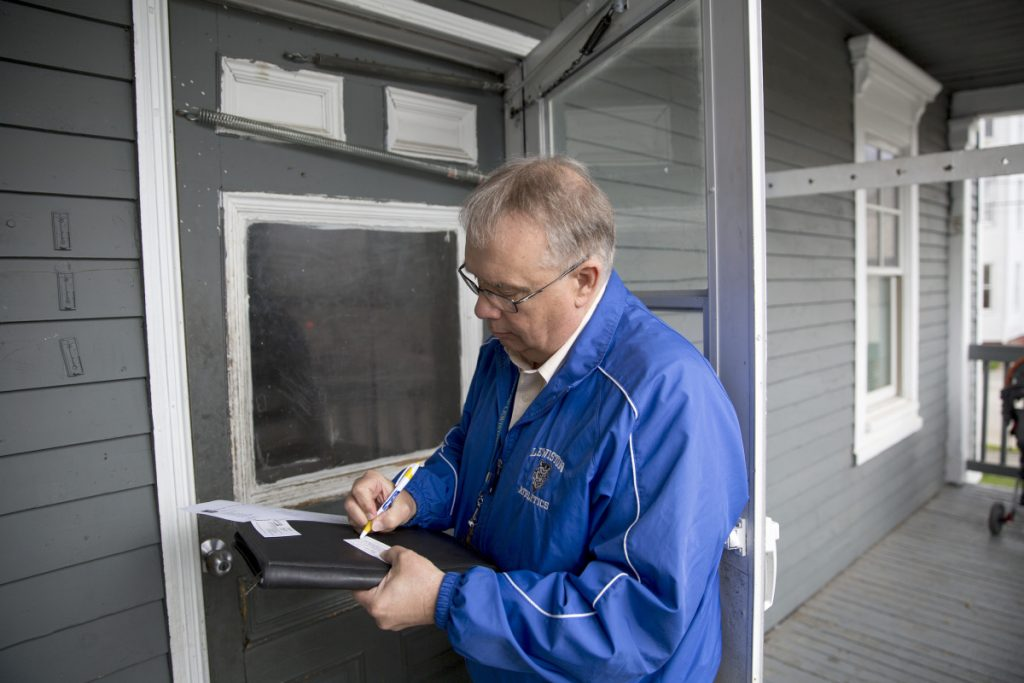 Butch Pratt, longtime truancy officer for the Lewiston school district, writes down his number and a note to leave on the door of an apartment where he hoped to discuss a student's absenteeism. Sixteen percent of Maine students – more than 29,000 – miss more than 10 percent of the school year, new state statistics show.