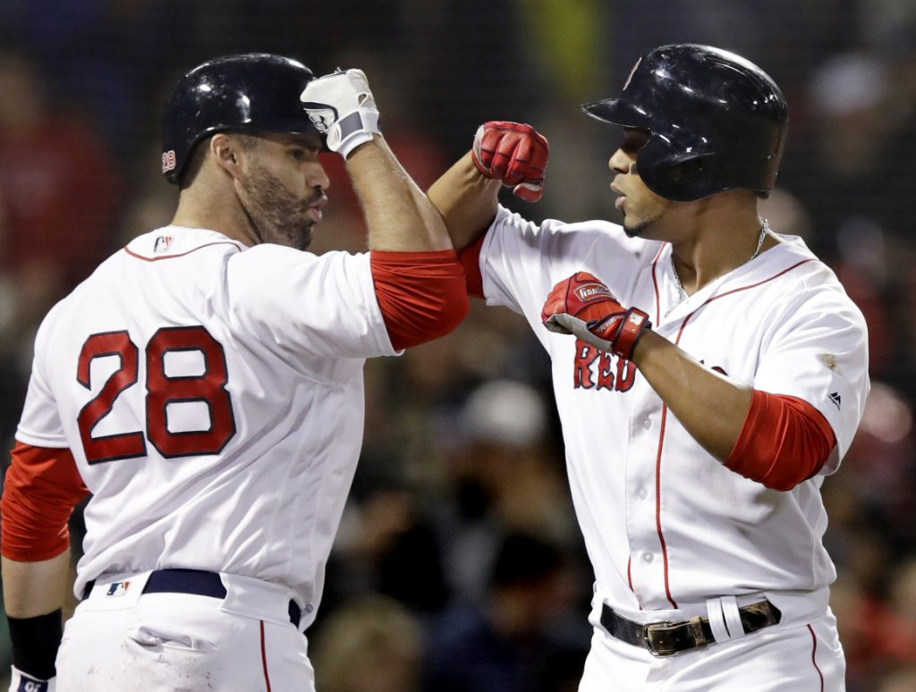Boston's Xander Bogaerts, right, is congratulated by J.D. Martinez after his solo home run against Detroit during the fifth inning of Tuesday's game at Fenway Park in Boston.