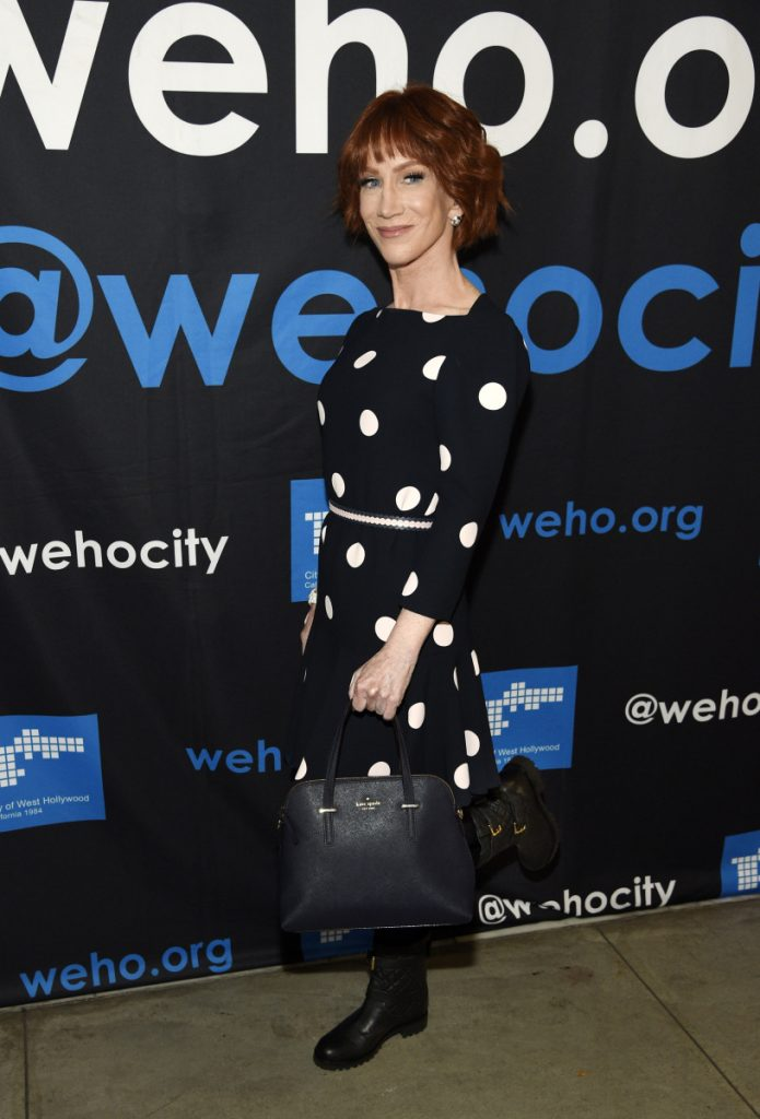 Comedian Kathy Griffin shows off her Kate Spade handbag and dress before receiving a Rainbow Key Award from the City of West Hollywood, Tuesday, June 5, 2018, in West Hollywood, Calif. Fashion designer Spade was found dead in her New York City apartment Tuesday in an apparent suicide, police said. (Photo by Chris Pizzello/Invision/AP)
