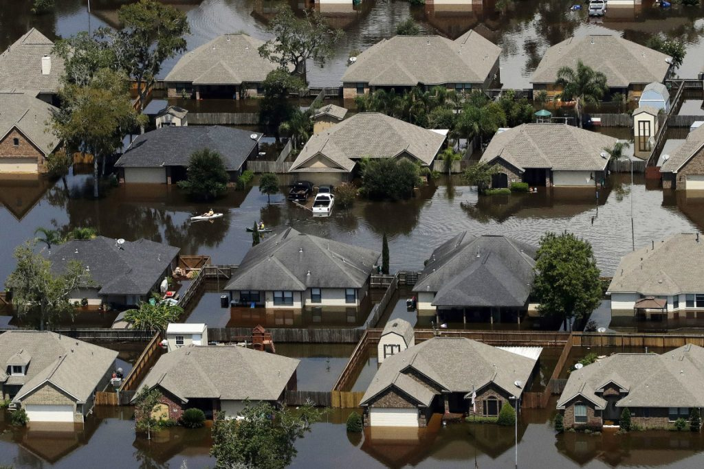 Homes are surrounded by water from the flooded Brazos River in the aftermath of Hurricane Harvey on Sept. 1, 2017, in Freeport, Texas. According to a study released on Wednesday, tropical cyclones around the world are moving slightly slower over land and water, dumping more rain as they stall, just as Hurricane Harvey did. Associated Press/Charlie Riedel