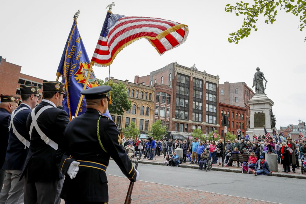 The VFW Honor Guard stands at attention as a crowd awaits speakers after Portland's Memorial Day parade May 28. A reader says a separate tribute to veterans in Scarborough deserved coverage.