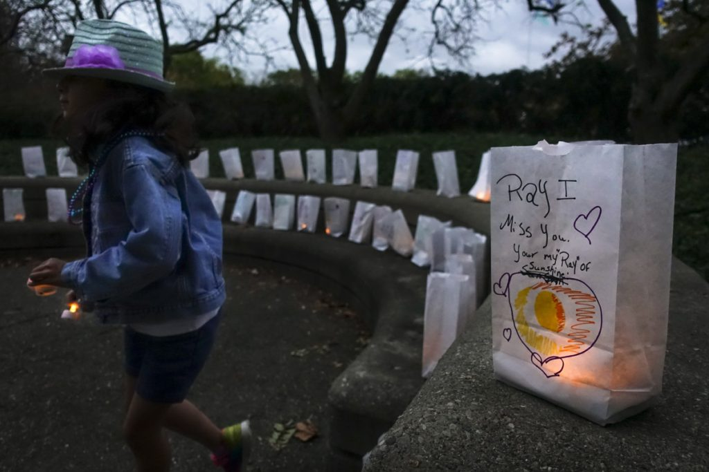 Paper bags with messages for the deceased line a suicide prevention walk in Cincinnati in 2017. Two recent celebrity deaths spur a reader familiar with mental illness  to repudiate the stigma attached.