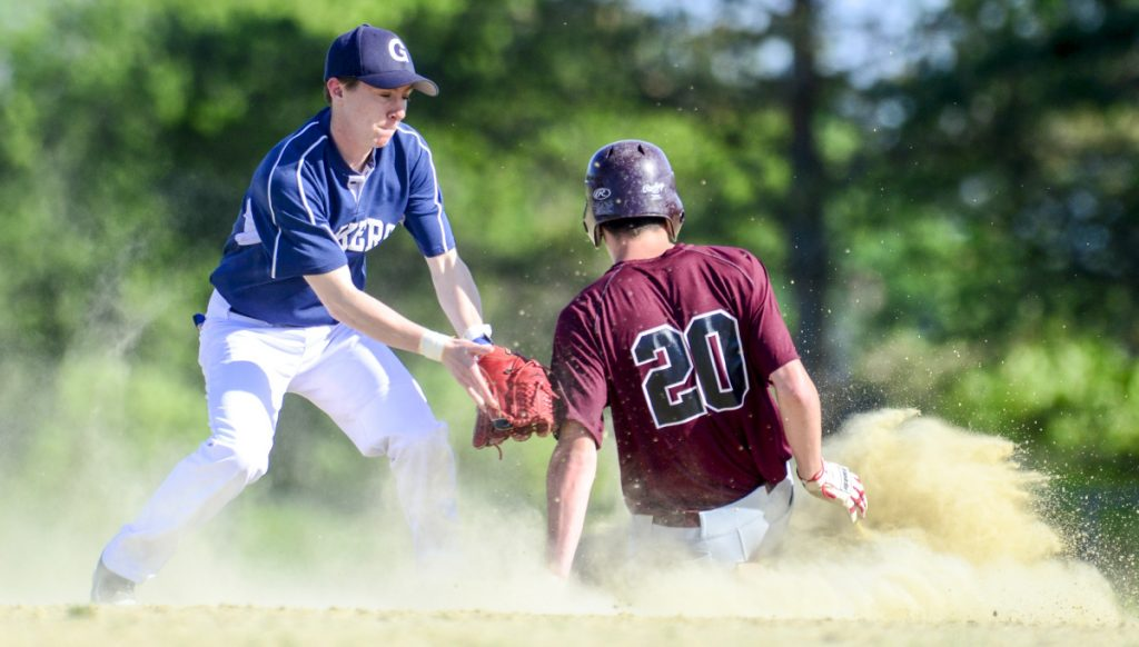 Greenville's Noah Pratt is too late with the tag as Richmond's Justin Vachon (20) slides safely into second during a Class D South semifinal on Friday in Richmond.