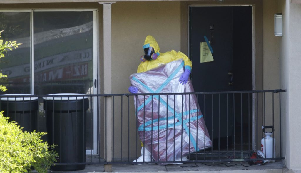 A hazardous-material cleaner removes a wrapped item in 2014 from the Dallas apartment where Thomas Eric Duncan, the first Ebola patient diagnosed in the United States, stayed. As the deadly virus re-emerges in the Congo, the risk of falling into apathy is very real in Washington.