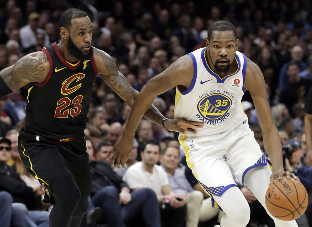 Kevin Durant, right, will sign a two-year contract to remain with Golden State, according to a person with knowledge of the deal, with the caveat that the contract will have an option and allow him to return to free agency next summer. Meanwhile, LeBron James, left, has everyone waiting for his decision.