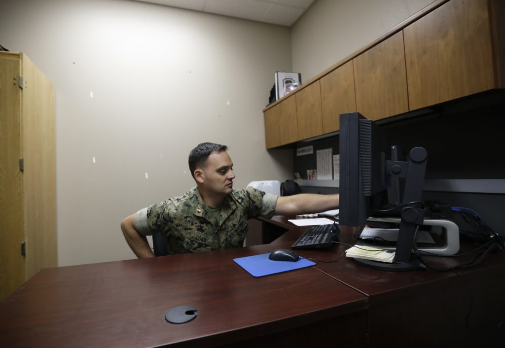Marine Chief Warrant Officer David Coan, 35, works at his desk in Camp Pendleton, Calif. Coan has applied to be a part of a new cyber force after serving 17 years in the Marines.