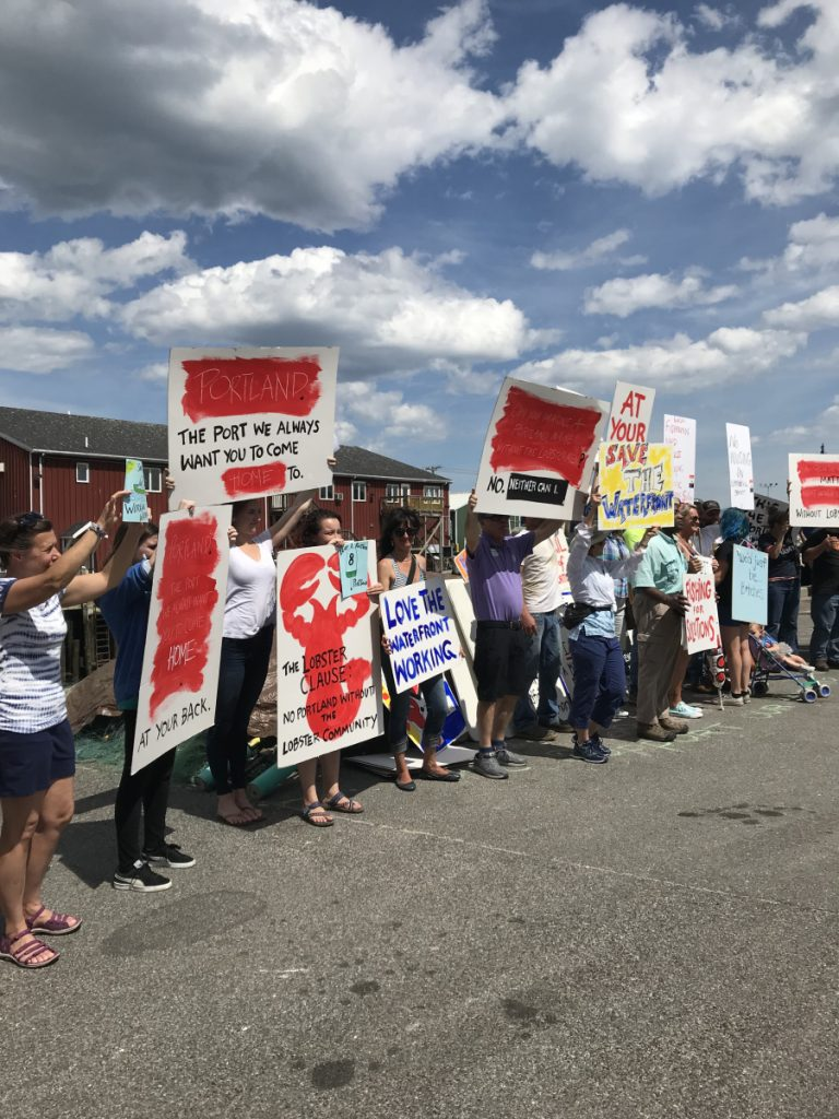 Fishermen, lobstermen and others protest Saturday at Union Wharf in Portland about planned development on the city's waterfront that they fear could leave the working waterfront behind. Staff photo by Eric Russell