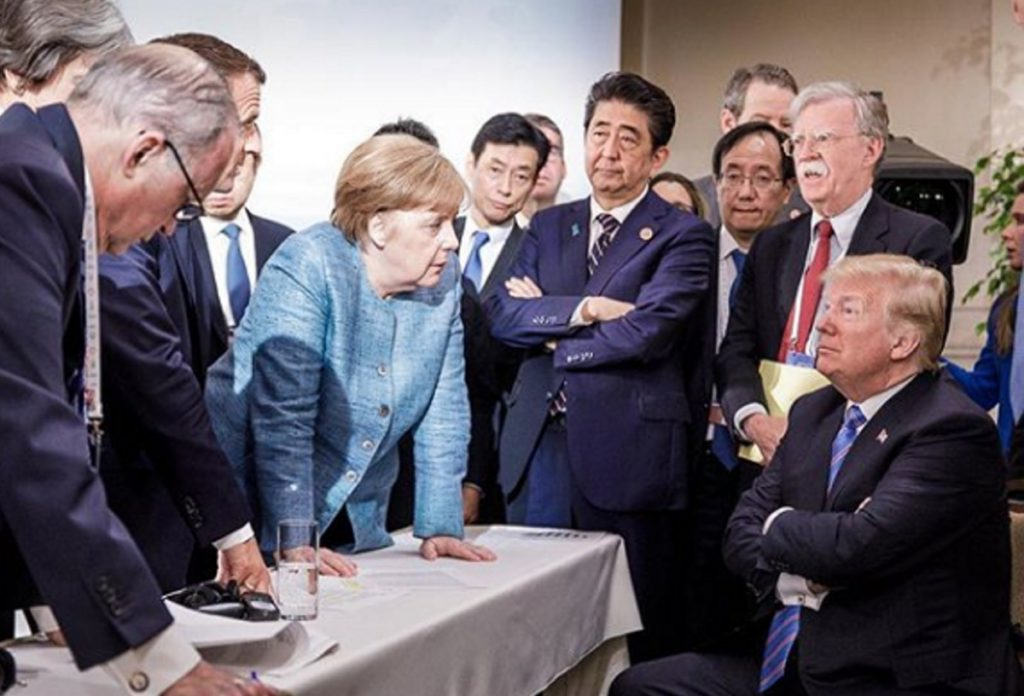 German Chancellor Angela Merkel and other G-7 leaders speak with President Trump as he prepares to leave early from the summit Saturday.