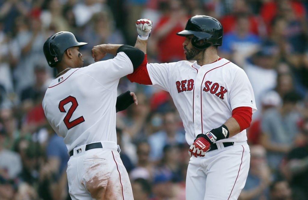 J.D. Martinez, right, and Xander Bogaert celebrate after Martinez hit a two-run home run, his 21st of the season, against the Chicago White Sox on Saturday in Boston.