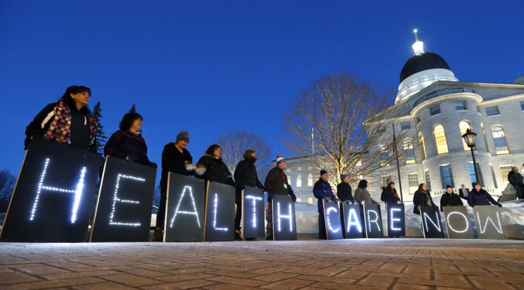 Mainers for Health Care rally outside the State House in Augusta in February.