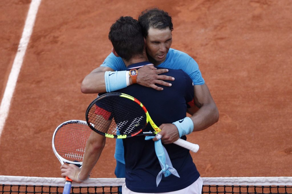 Rafael Nadal hugs Dominic Thiem after defeating him in the French Open men's final. Nadal won 6-4, 6-3, 6-2.