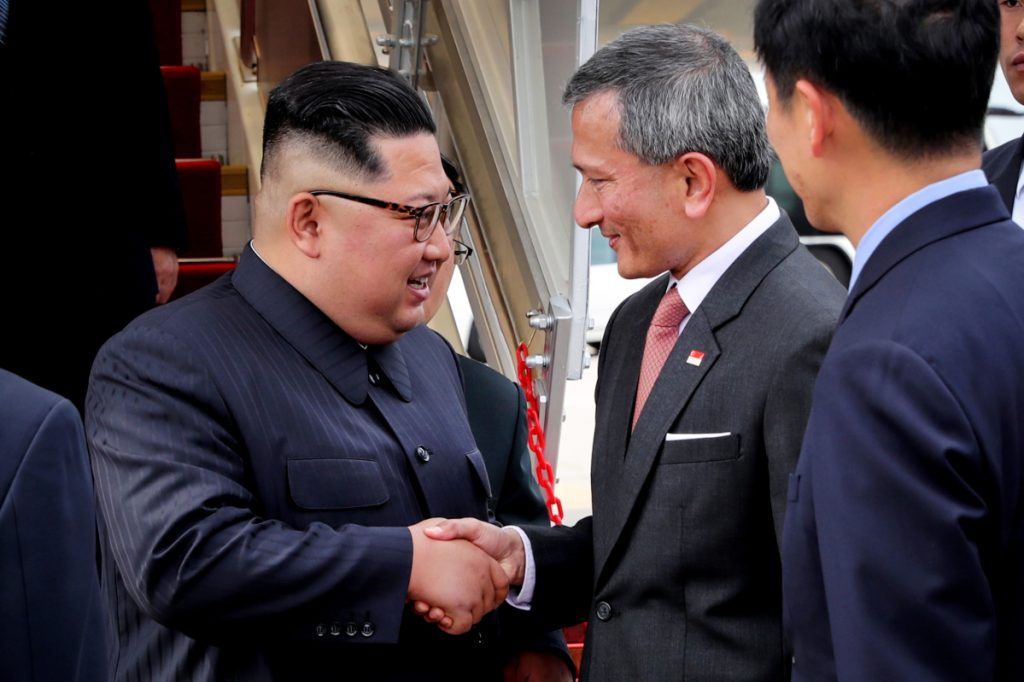Singaporean Foreign Minister Vivian Balakrishnan, right, greets North Korean leader Kim Jong Un at Singapore's Changi airport.