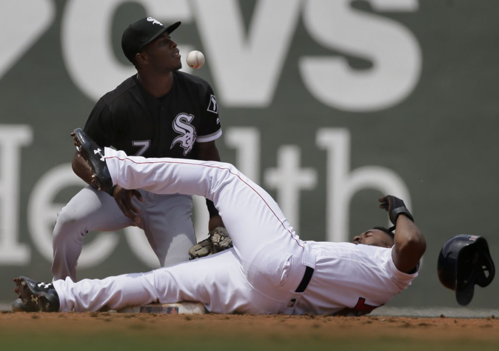 Boston's Jackie Bradley Jr., bottom, steals second base as Chicago's Tim Anderson, top, is unable to get his glove on the ball in the second inning of Chicago's 5-2 win Sunday in Boston.