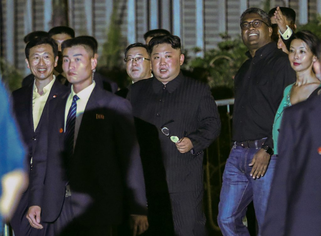 North Korea leader Kim Jong Un, center, is escorted by his security delegation as he visits Marina Bay in Singapore on Monday prior to a summit with President Trump.