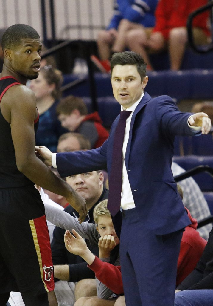 Josh Longstaff, right, the head coach for the Erie BayHawks will be an assistant coach with USA Basketball for the World Cup.
