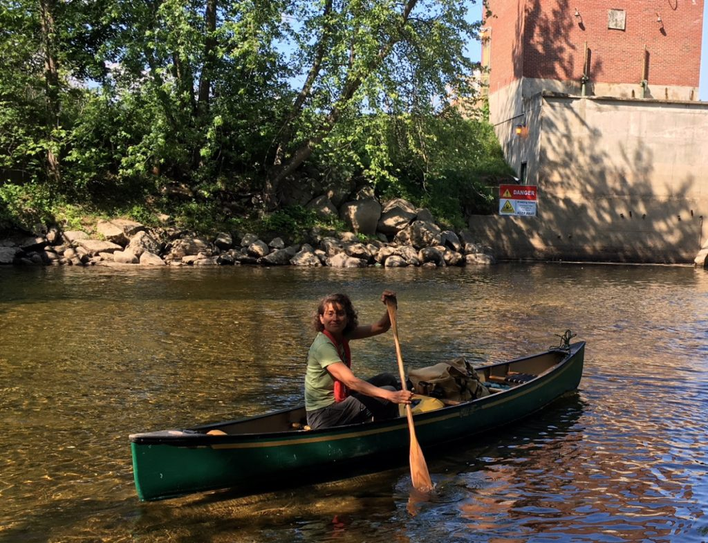 Jen Deraspe paddles from the Swift River boat launch in Mexico on Friday. A native of the town, she is canoeing the length of the Androscoggin River – 173 miles from Errol, New Hampshire to Topsham, Maine. Her goal is to raise at least $5,000 for mainerivers.org.