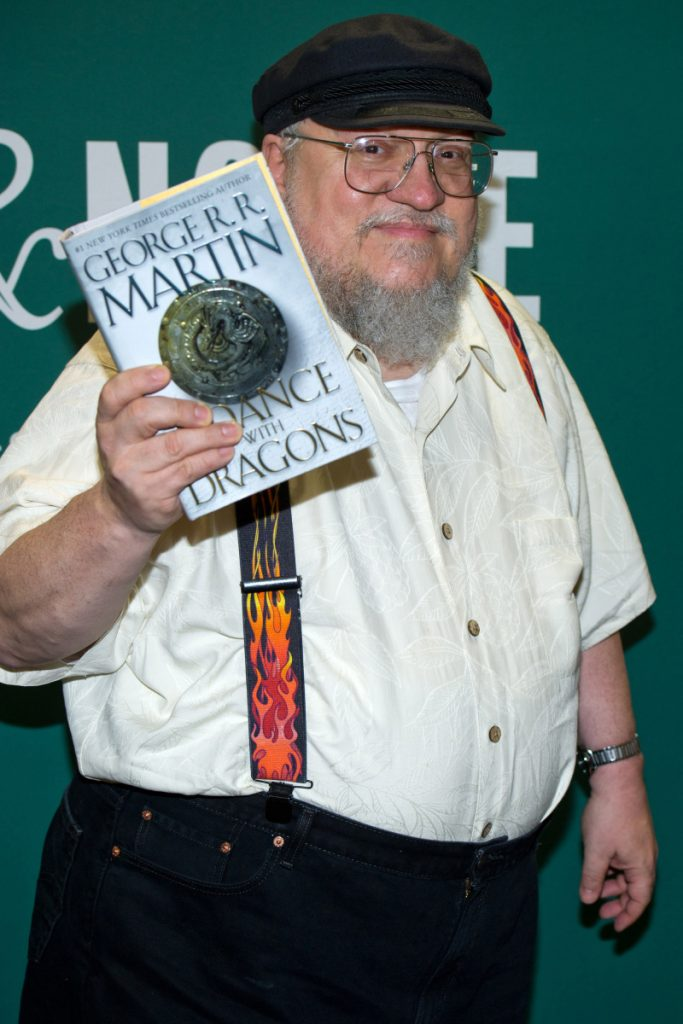 "Author George R.R. Martin appears at a book signing for ""A Dance with Dragons"" in 2011. Martin hinted that none of the characters from 'Game of Thrones' will appear in the new show."