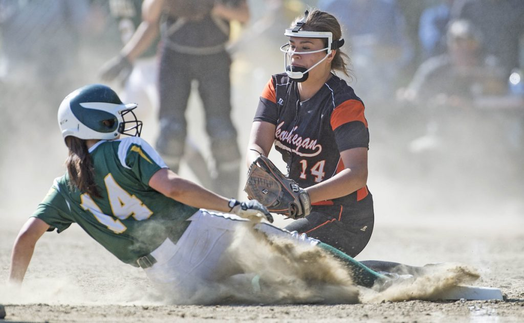Ashley Child of Oxford Hills slides safely into third base before Skowhegan's Lindsey Warren can apply the tag during the Class A North championship game Tuesday at Winslow High. Oxford Hills won, 7-3.