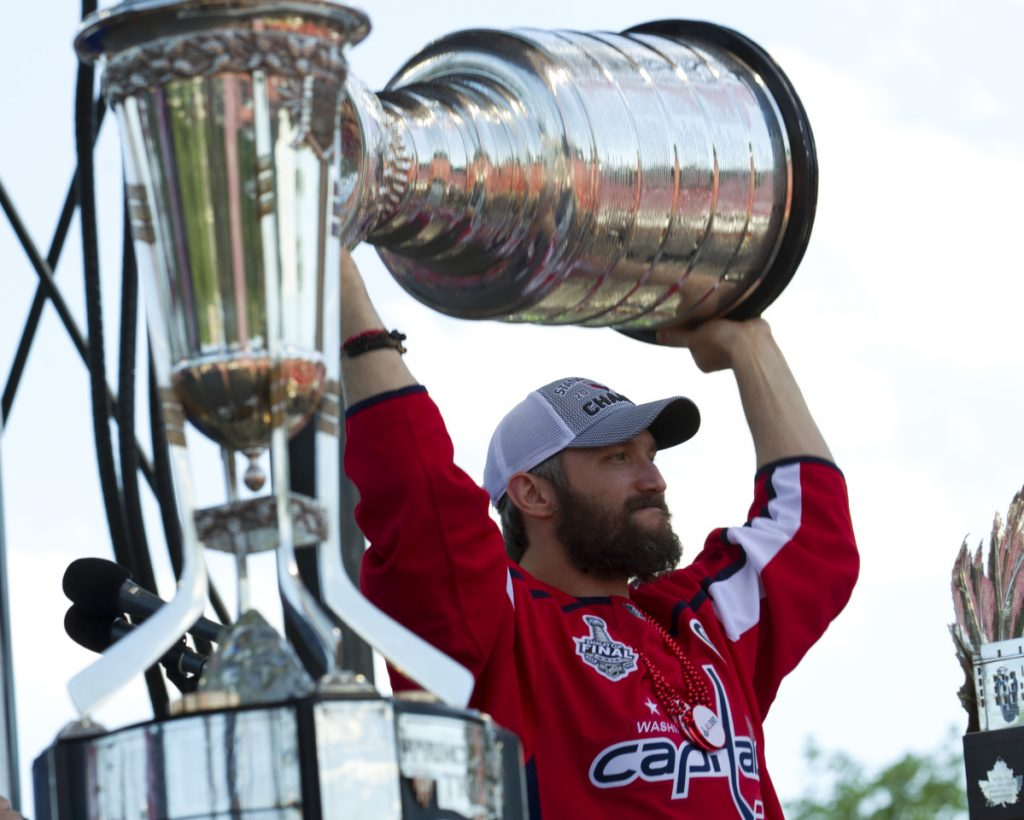 Alex Ovechkin holds up the Stanley Cup during a victory parade Tuesday in Washington, D.C. The Caps beat the Golden Knights in five games for their first title.