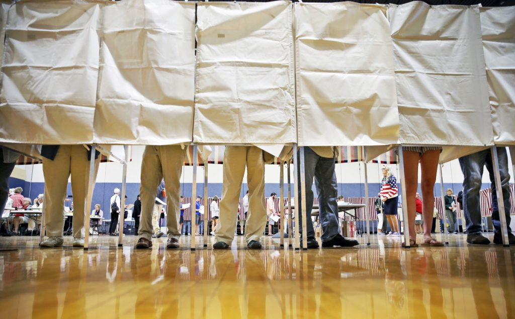 Falmouth residents stand booth-to-booth Tuesday during a busy Election Day at the local high school. Despite dire predictions, ranked-choice voting didn't cause widespread confusion among Maine voters.