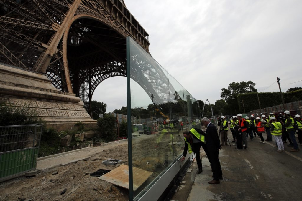 The new security bulletproof glass barrier under construction around the Eiffel Tower in Paris.