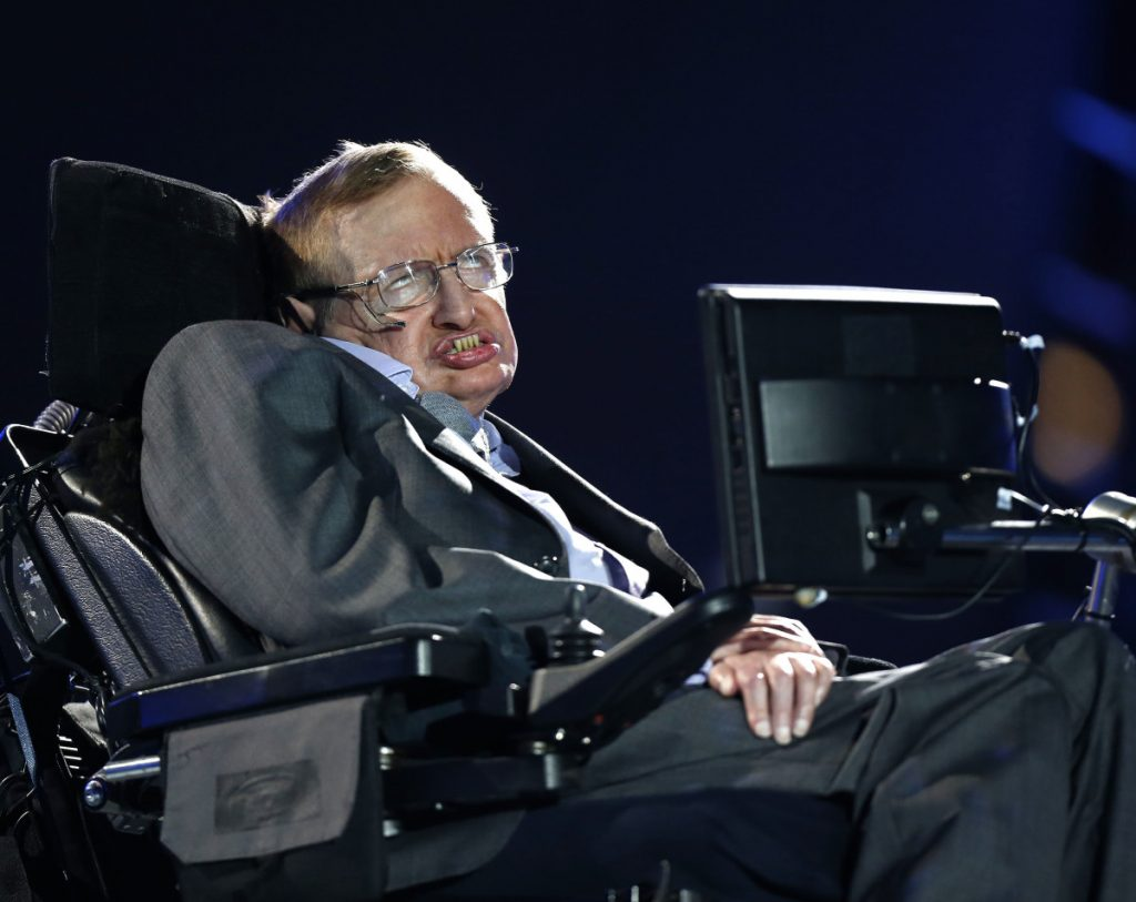 British physicist Stephen Hawking's ashes were buried Friday between the graves of Charles Darwin and Isaac Newton.