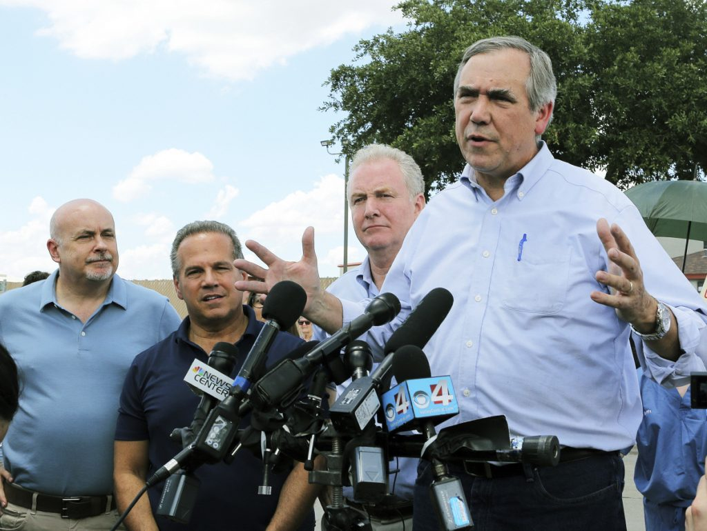 U.S. Sen. Jeff Merkley, D-Oregon, speaks to the media in front of the U.S. Customs and Border Protection's Centralized Processing Center in McAllen, Texas, on Sunday. Looking on are Sen. Chris Van Hollen, D-Md., center; U.S. Rep. David Cicilline, D-R.I., and U.S. Rep. Mark Pocan, D-Wis., left.