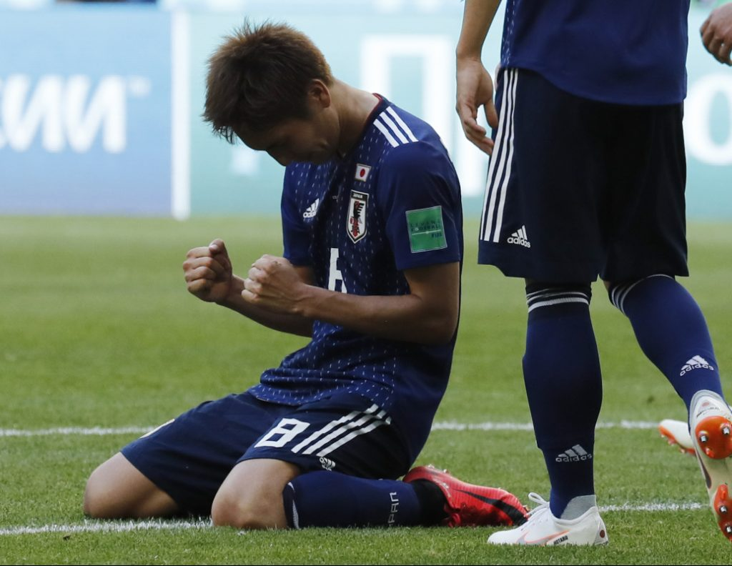 Genki Haraguchi celebrates the 2-1 win during Japan's  group H match against Colombia at the World Cup on Tuesday.