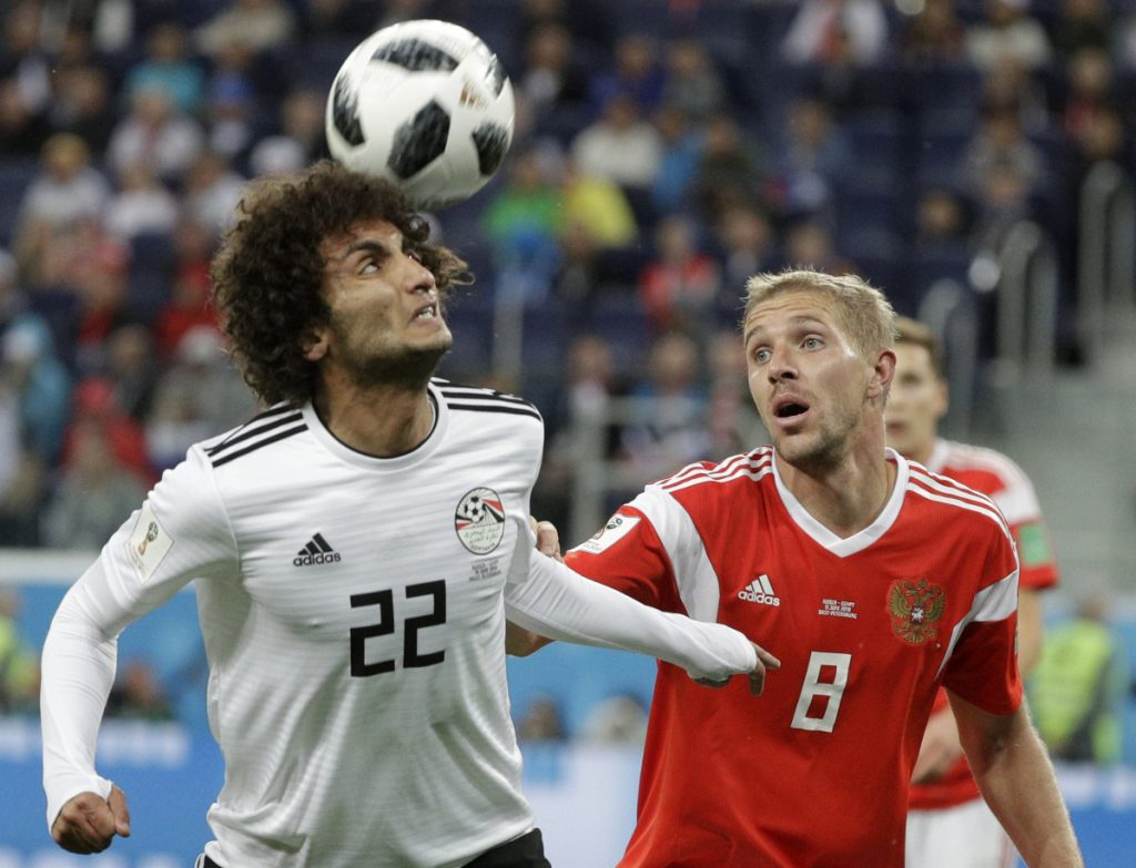 Russia's Yuri Gazinsky, right, challenges for the ball with Egypt's Amr Warda during the match between Russia and Egypt at the 2018 World Cup in the St. Petersburg stadium in St. Petersburg, Russia on Tuesday.