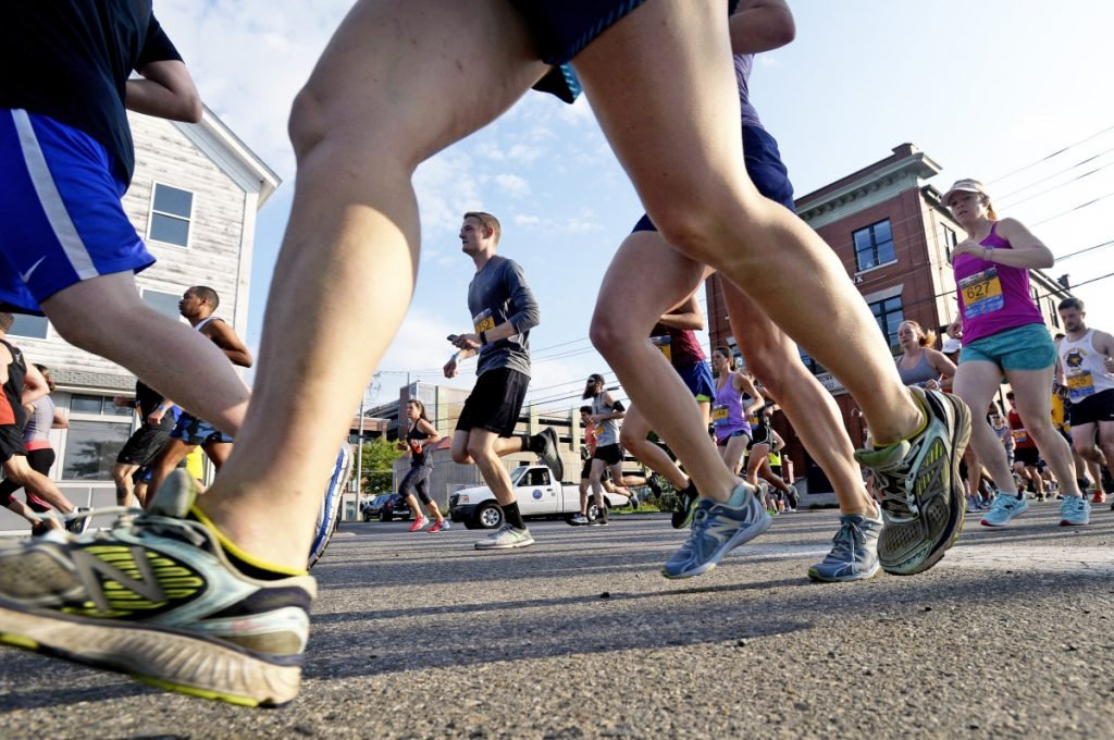 Runners make their way down Commercial St. near the start of the Old Port Half Marathon  on July 8, 2017.  (Staff photo by Shawn Patrick Ouellette)