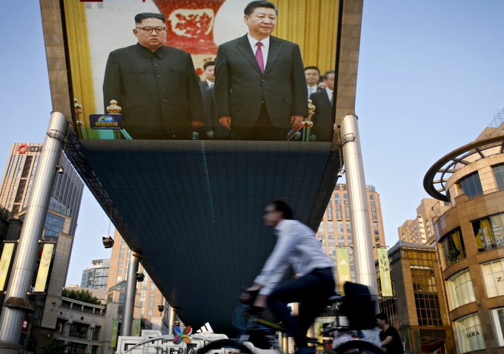 A TV screen broadcasts the opening Tuesday of two days of talks between North Korean leader Kim Jong Un, left, and Chinese President Xi Jinping. Kim is likely hoping to get China's support for relief from punishing U.N. sanctions imposed in an effort to persuade the North to back off on its nuclear ambitions. Associated Press/ Andy Wong