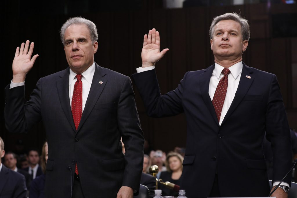 Michael Horowitz, inspector general with the Department of Justice, left, and Christopher Wray, director of the Federal Bureau of Investigation, being sworn in at the  Senate Judiciary Committee hearing on Monday.