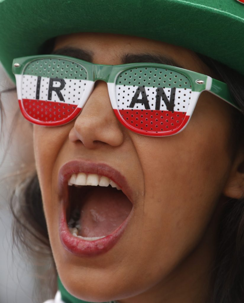 An Iranian fan cheers on her team during its opening World Cup match Friday against Morocco.