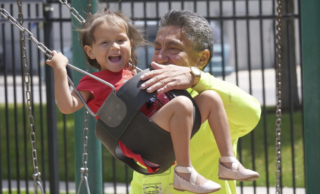 Romulo Gonzalez Rodriguez plays with his 3-year-old daughter, Genesis, on Tuesday in Provo, Utah. The two were kept apart for a week in November after arriving in San Diego.