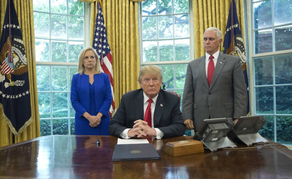President Trump, with Homeland Security Secretary Kirstjen Nielsen and Vice President Mike Pence, before signing an executive order Wednesday to end family separations at the border.