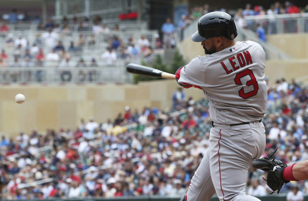 Boston's Sandy Leon gets a hit in the fourth inning Thursday's 9-2 win over the Twins in Minneapolis.