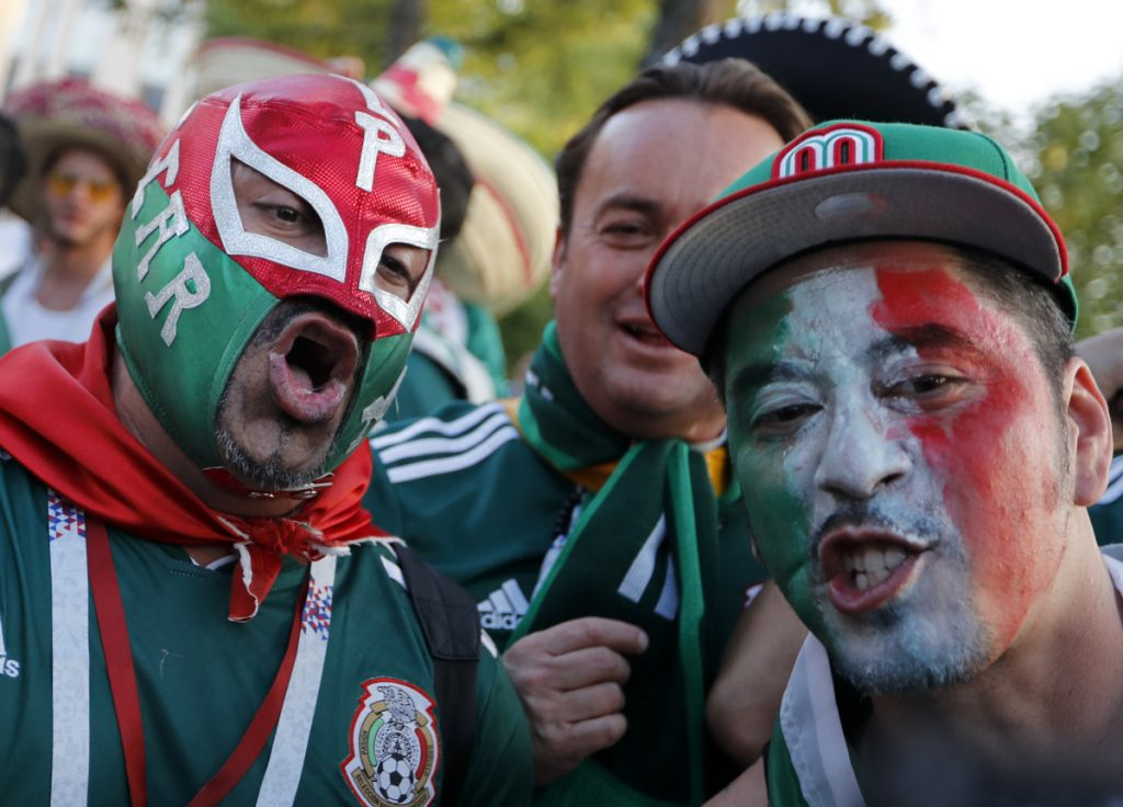 Mexico soccer fans celebrate their team's victory against Germany on Sunday. The country's football federation drew a fine for fans' use of a chant that's considered homophobic.