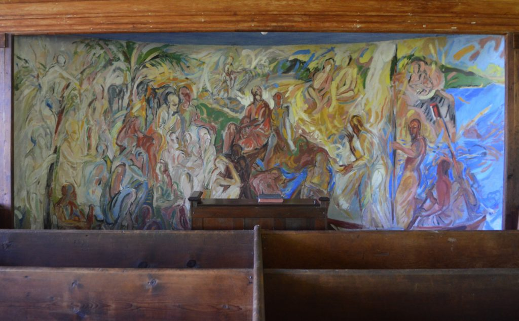 The center panel on the east wall, by Ashley Bryan, depicts the Parable of the Sower.