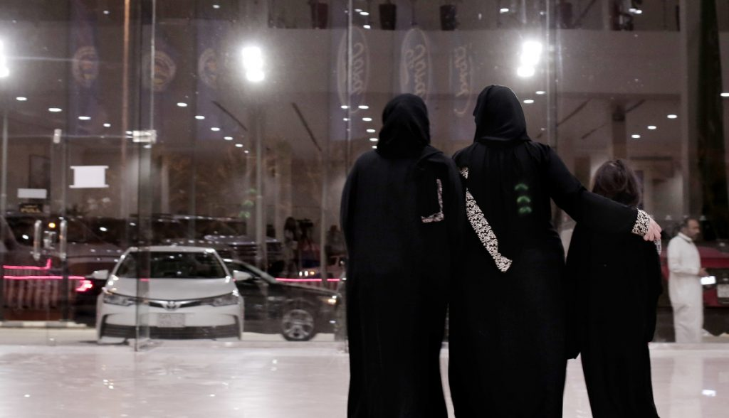Women leave after looking at cars at the Al-Jazirah Ford showroom in Riyadh, Saudi Arabia, on Thursday.