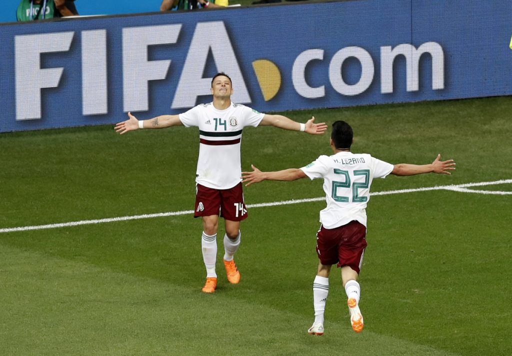 Mexico's Javier Hernandez, left, celebrates with teammate Hirving Lozano after scoring his teams second goal during the match between Mexico and South Korea at 2018 World Cup at Rostov Arena in Russia on Saturday.