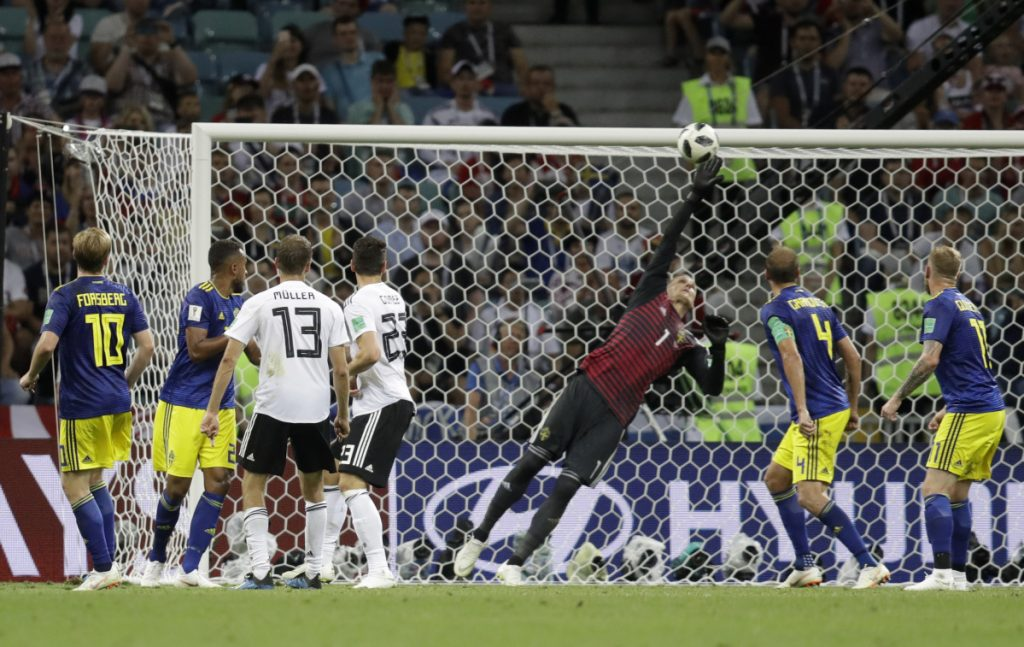 Sweden goalkeeper Robin Olsen leaps but can't reach a shot by Toni Kroos in the 95th minute that gave Germany a 2-1 win Saturday in Sochi, Russia.
