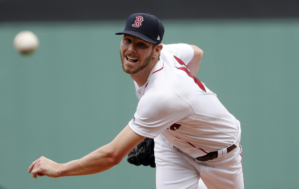 Boston Red Sox starting pitcher Chris Sale pitched seven scoreless innings, striking out 13, walking one and allowing four hits in a 5-0 win over the Seattle Mariners on Sunday at Fenway Park in Boston.