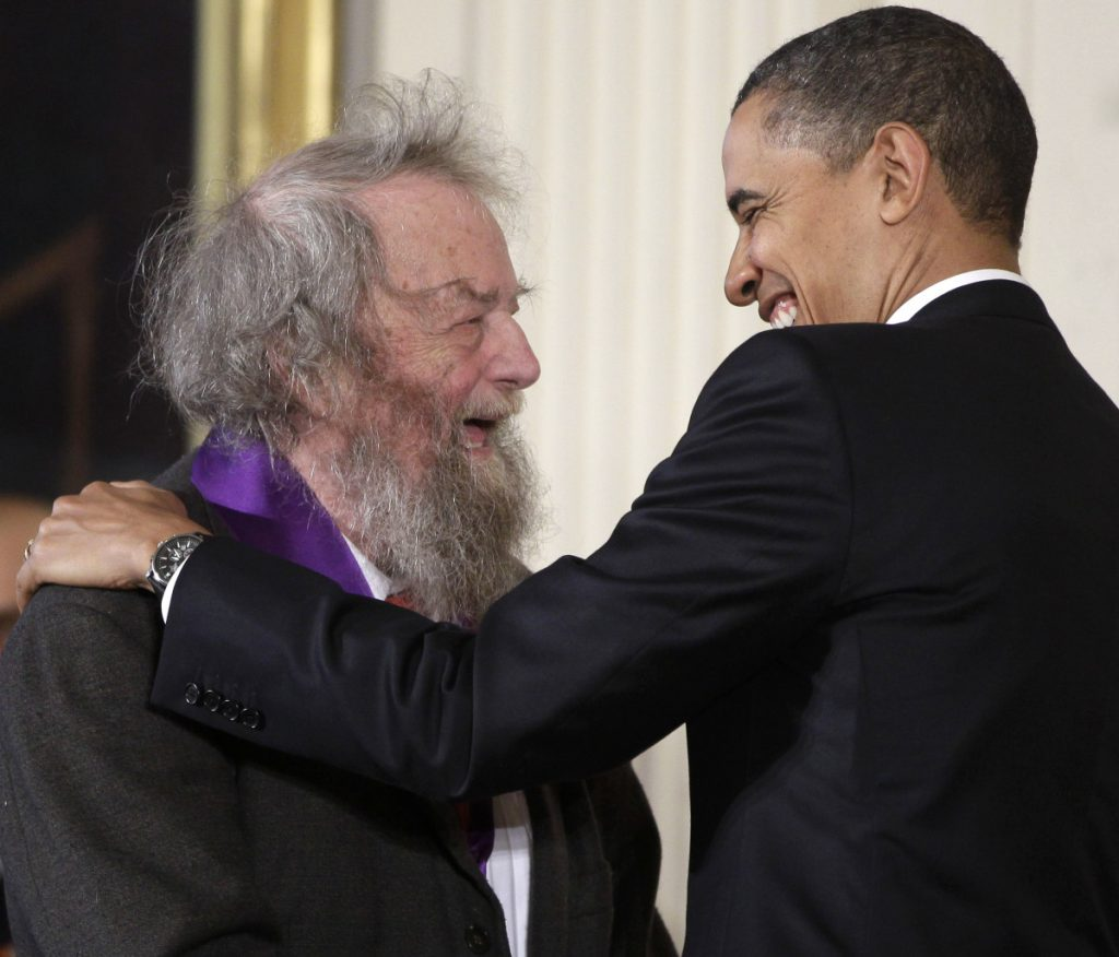 President Obama presents a 2010 National Medal of Arts to poet Donald Hall in 2011, during a ceremony in the East Room of the White House in Washington.