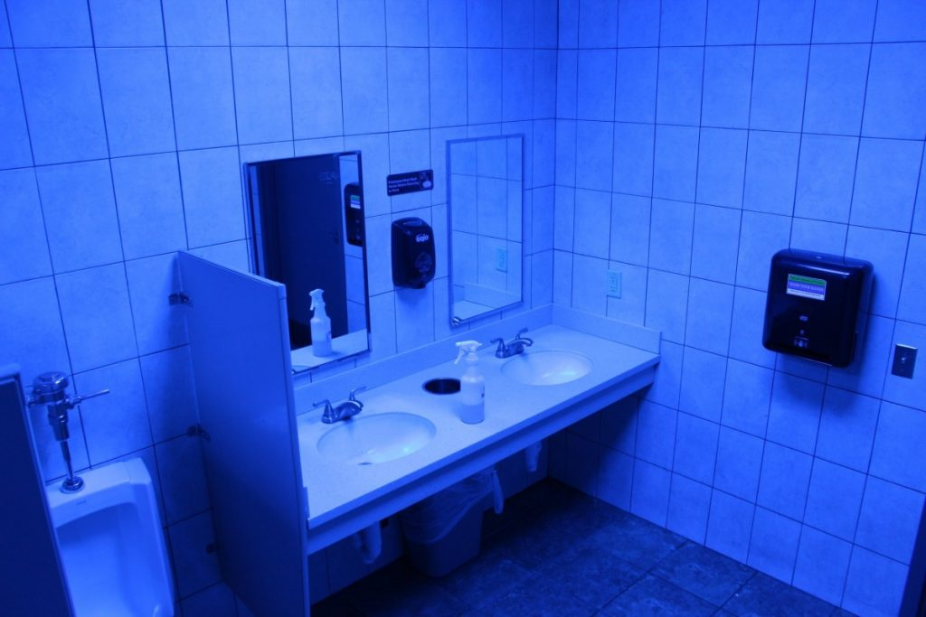 A public bathroom bathed in blue light is seen at this Turkey Hill convenience store in Wilkes-Barre, Pa. The chain has installed the blue light bulbs in as many as 20 stores in hopes of discouraging drug use by making it harder for people to see their veins.