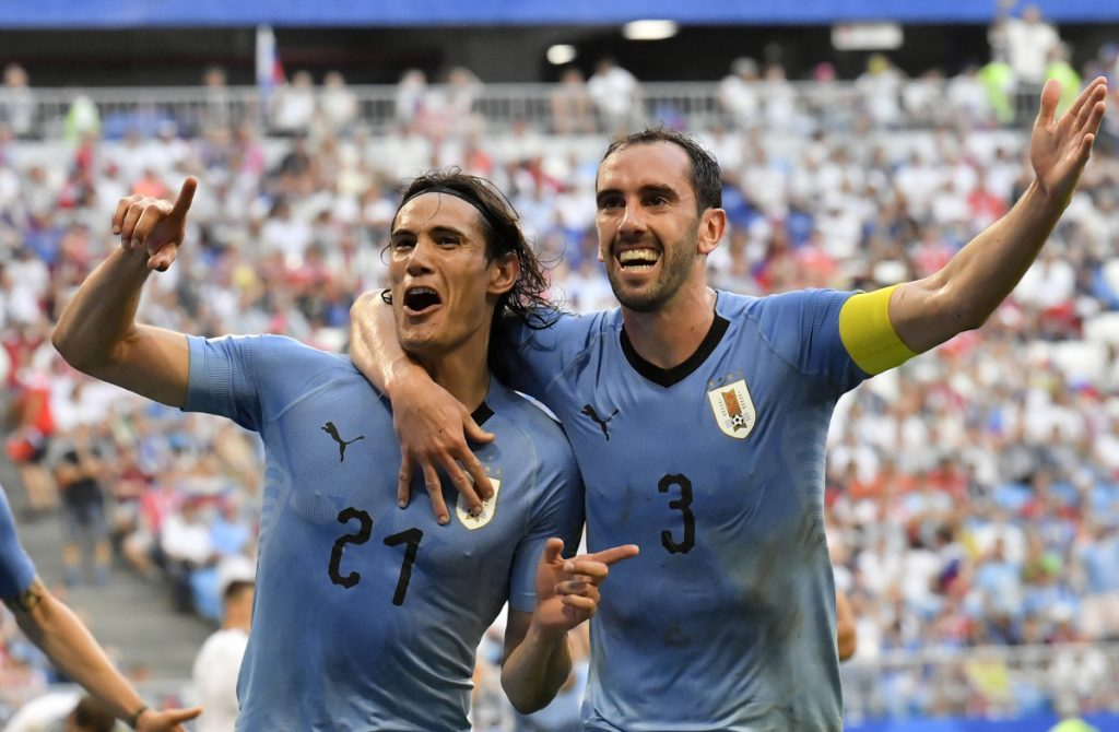 Uruguay's Edinson Cavani celebrates with teammate Diego Godin, right, after scoring his team's third goal during their match against Russia at the 2018 soccer World Cup at the Samara Arena on Monday. ()