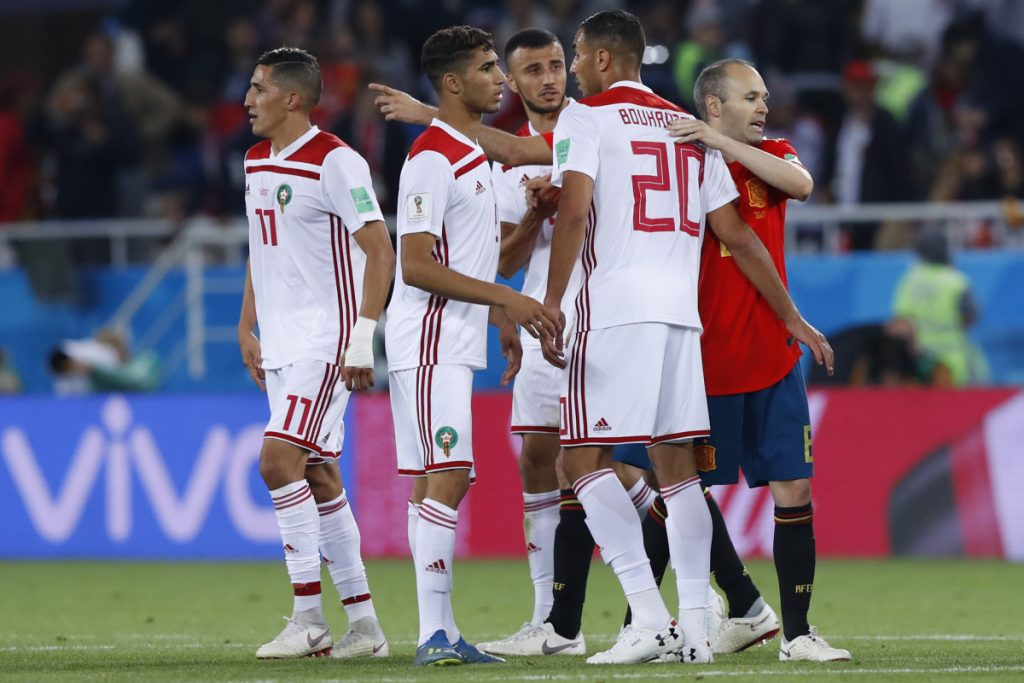 Spain's Andres Iniesta, right, hugs Morocco's Aziz Bouhaddouz after the Group B match between Spain and Morocco at the World Cup Monday at the Kaliningrad Stadium in Kaliningrad, Russia. The game ended in a 2-2 draw.