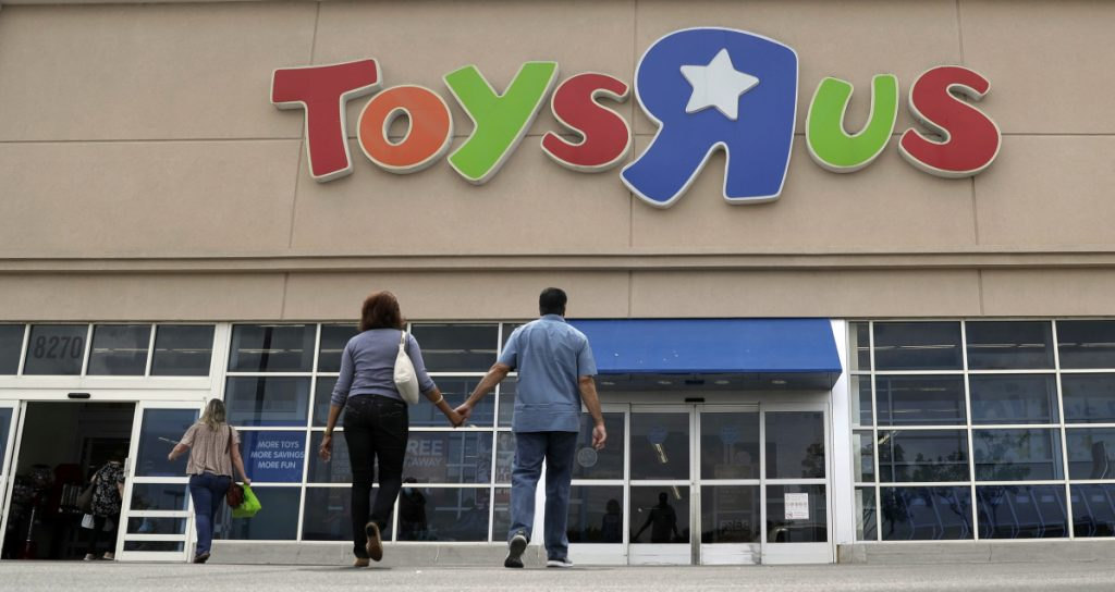 Shoppers walk into a Toys R Us store in San Antonio in September 2017. Toys R Us began liquidating its U.S. business earlier this year – and Party City wants to capitalize on it.