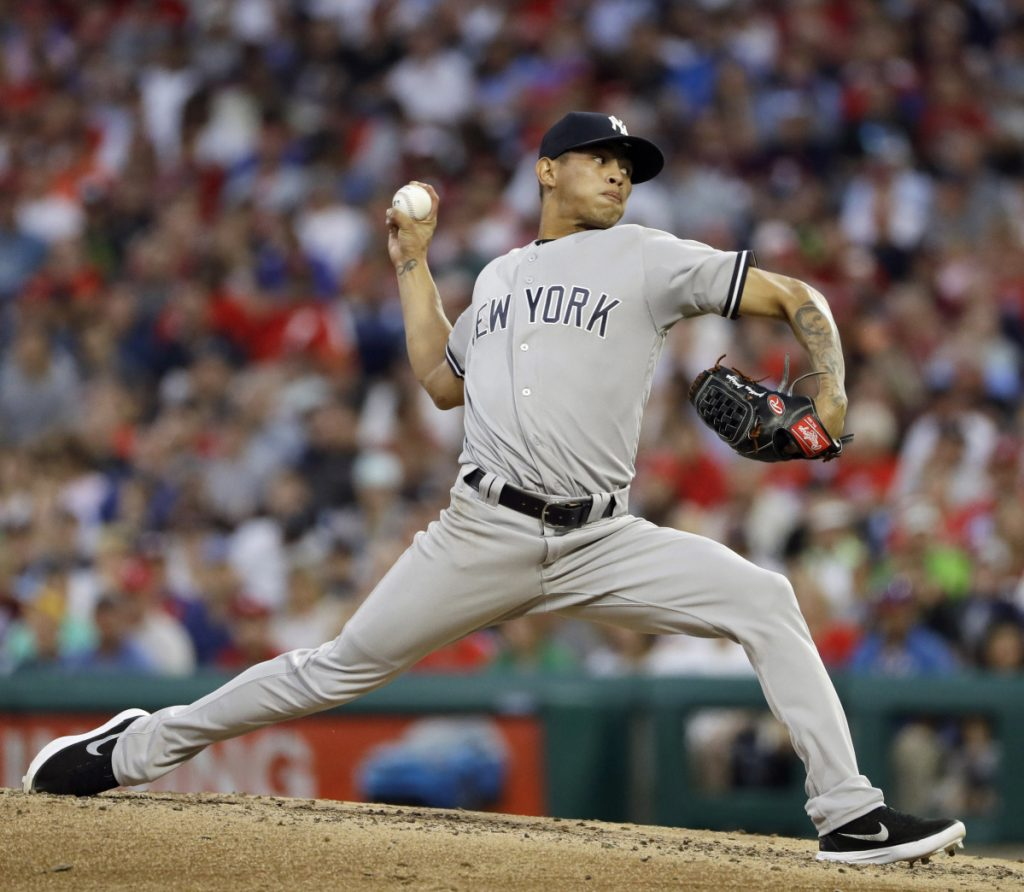 New York's Jonathan Loaisiga delivers a pitch in the fourth inning Monday night against the Phillies in Philadelphia. Loaisiga allowed one hit, struck out eight and walked two in 5  innings and the Yankees won 4-2.