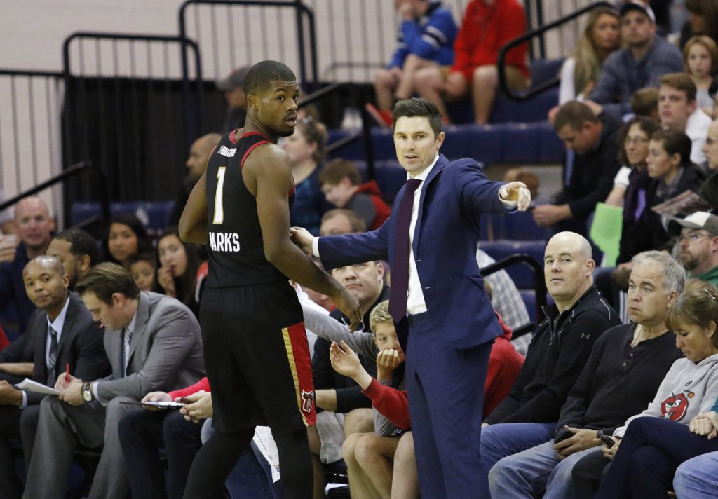 Josh Longstaff, right, served last season as head coach of the G League's Erie BayHawks. He'll be an assistant coach with the NBA's Milwaukee Bucks next season. (Staff Photo by Joel Page/Staff Photographer)